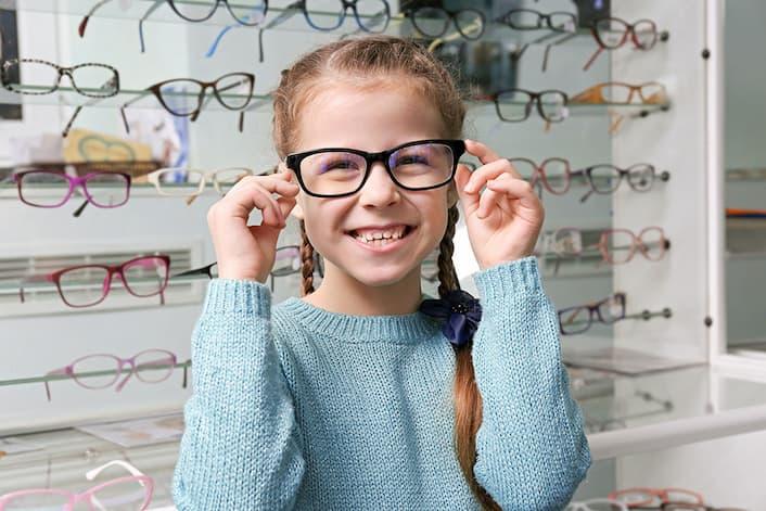 Girl Trying Glasses